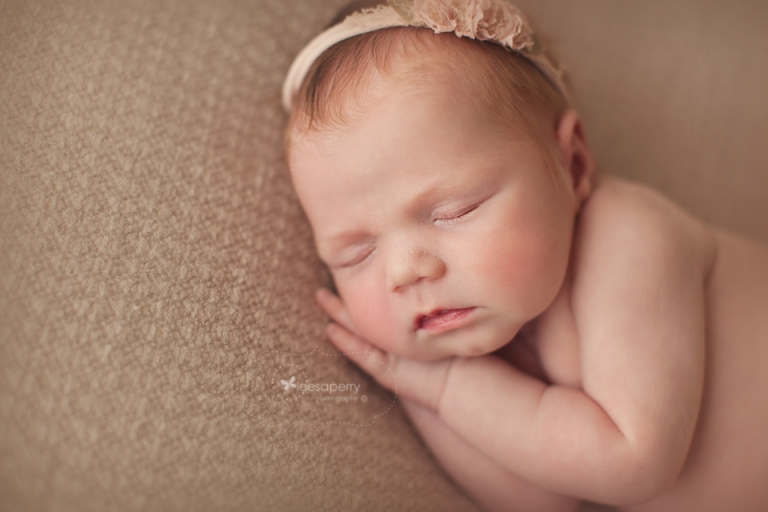 newborn baby girl in pinks and neutral colours